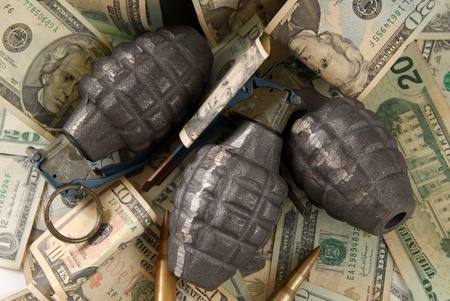 nad': Hand grenades nad bullets on top of american currency