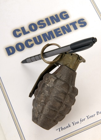 A hand grenade rigged to blow up when loan documents are signed