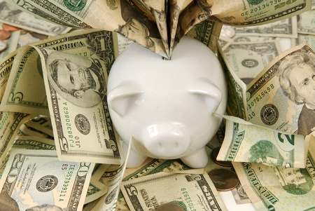 overflows: A piggy bank overflows with saved money