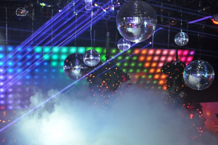 Disco balls and laser light shows in a nightclub Stock Photo