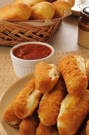 a plate of deep fried breaded mozzarella cheese sticks