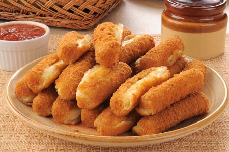 breaded: A plate of fried cheese mozzarella cheese sticks