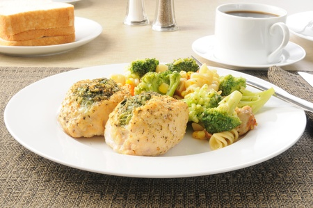 Stuffed chicken breasts with pasta salad and sliced bread Stock Photo - 12268045