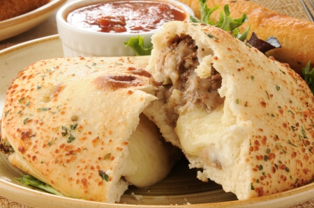 Macro photo of a steak and cheese calzone Stock Photo