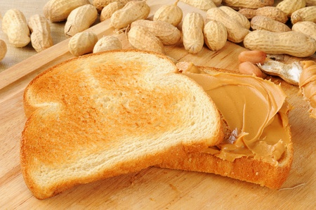 peanut butter: A peanut butter sandwich on toast