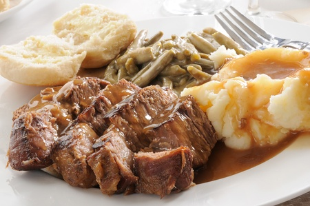 Roast beef smoothered in mushroom gravy with mashed potatoes