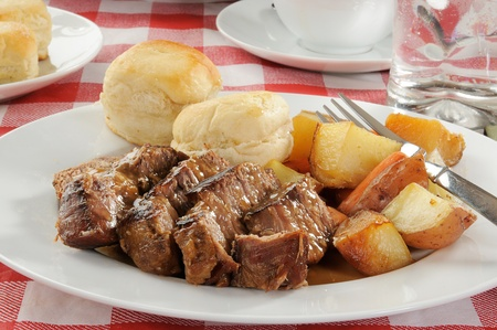 roast potatoes: A plate of pot roast with autumn vegetables