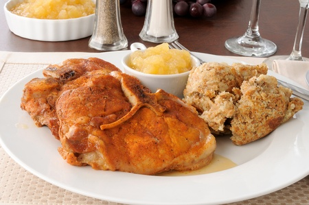 breaded pork chop: Baked pork chops with herbed stuffing Stock Photo