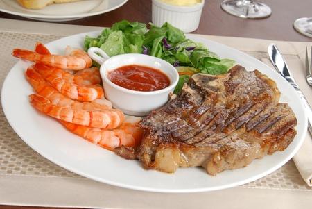 A grilled rib steak with tiger shrimp prawns Stock Photo - 12268089