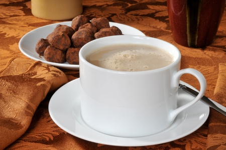 A cup of mocha latte and caramel tuffles Stock Photo - 12268112
