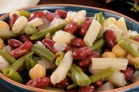 Close up photo of a bowl of four bean salad