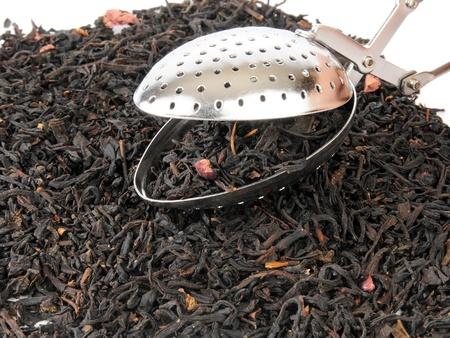 Whole leaf black pomegranate tea with an infuser photo