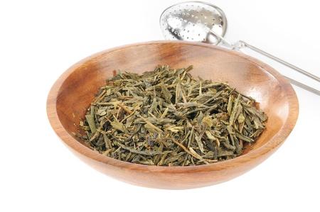 sencha tea: Whole leaf organic China Sencha tea in a bowl with an infuser