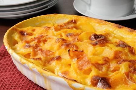 au: A casserole dish of hot au gratin potatoes with ham Stock Photo