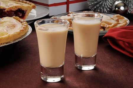 shooters: Two Irish cream shooters in shot glasses with Christmas candies and pies