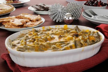 A hot green bean casserole on a holidaydinner table