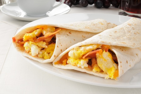 tortillas: Two bacon and egg burritos with coffee