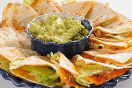 tortillas: Closeup photo of quesadillas with guacamole Stock Photo