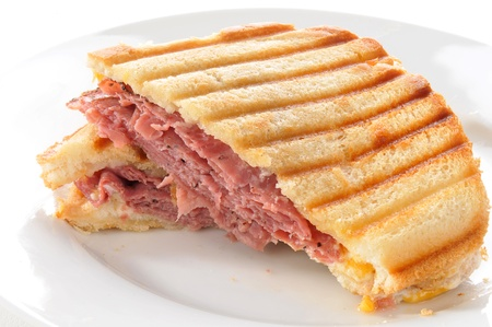 panini: A beef panini with swiss and cheddar cheese