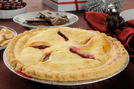 brittle: A fresh baked cherry pie with peanut brittle, chocolates and Christmas decorations