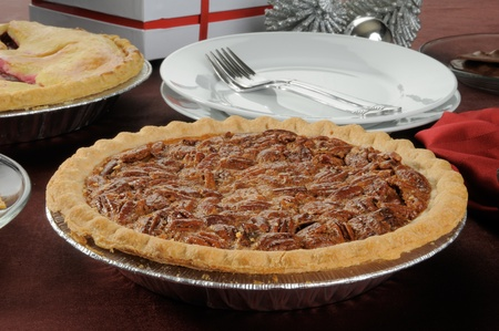 A fresh baked pecan and cherry pie at Christmas Stock Photo - 12268288