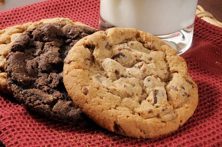 Assorted cookies with a glass of milk on a red towel photo