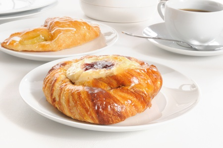 raspberry jelly: A cheese Danish with raspberry jelly and an apple croissant