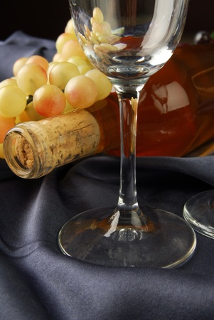 A bottle of champagne with grapes and wine glasses Stock Photo - 12268254