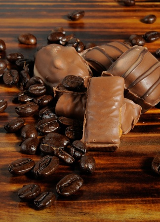 Chocolate candy and fresh roasted coffee beans