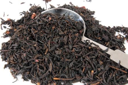 A measuring spoon of whole leaf black pomegranate tea photo