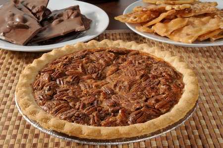 pecan: A pecan pie with peanut brittle and chocloate almond bark Stock Photo