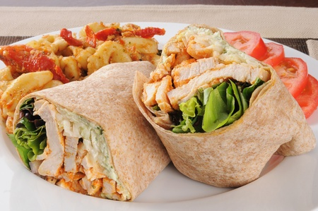 Chicken wraps with tomatoes and tortellini photo