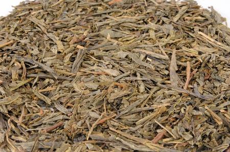 loose leaf: Antecedentes de hojas sueltas de porcelana de t� verde Sencha Foto de archivo