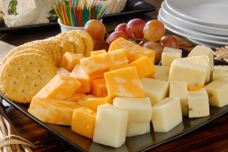 A plate of cheese and crackers on a party buffet table Stock Photo - 12268507