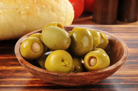 a bowl of green olives sstuffed iwth anchovies