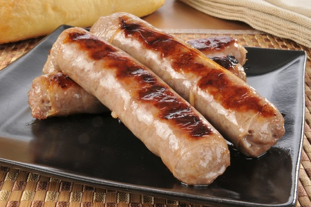 A plate of grilled bratwurst or sausages Banco de Imagens