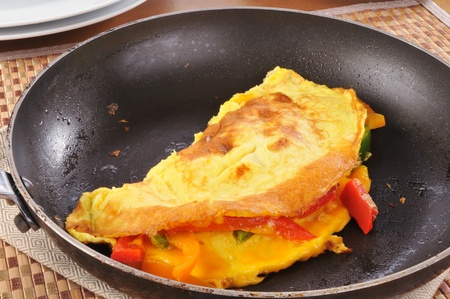 skillet: a western omelet in a skillet Stock Photo