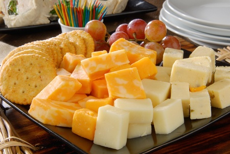 A plate of cheese and crackers on a party buffet table photo