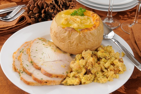 Turkey dinner with butternut squash soup and dressing photo