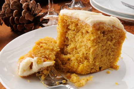 A slice of pumpkin bundt cake with butter cream caramel icing