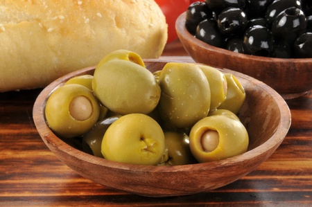 A bowl of green olives stuffed with minced anchovies