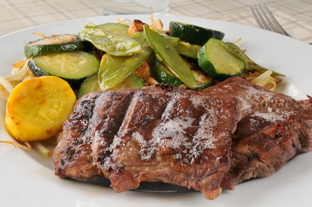 broiled: Lean broiled steak with stir fried vegetables