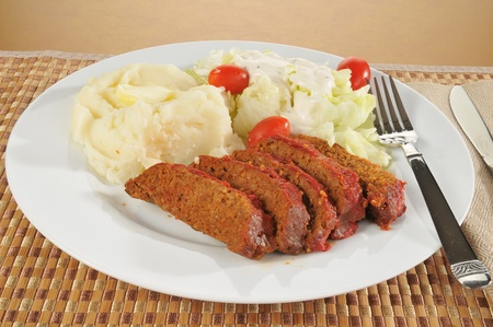 meatloaf: A plate of meatloaf with mashed potatoes