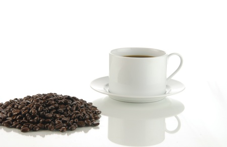 A cup of black coffee next to fresh ground beans Stok Fotoğraf