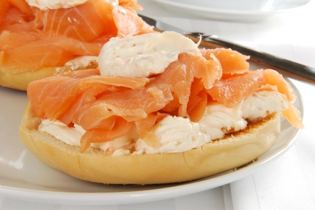 A toasted bagle with lox and cream cheese close up photo