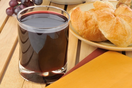 concord grape: Glass of grape juice with croissants