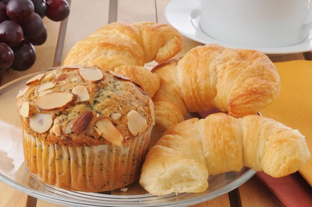 A plate of crossaints with an almond muffin Stock Photo - 12675805