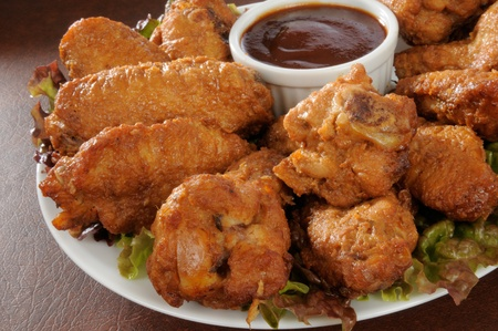 Closeup photo of a plate of chicken wings with barbecue sauce photo