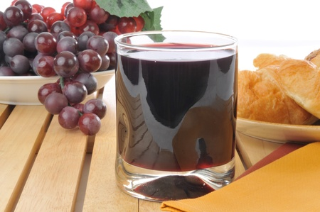 concord grape: Fresh grape juice and croissants Stock Photo