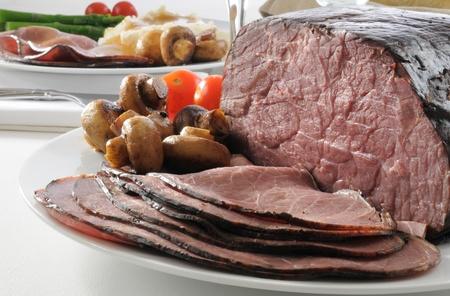 Thin sliced rare roast beef on the dinner table Archivio Fotografico